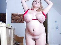 Plump ash-blonde with humungous boobs and hefty cootchie taking off her bikini
