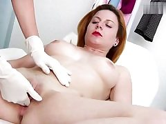 Insane red haired stunner gets her cunt slot examined on a gyno tabouret
