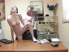 Skinny whore gets tucked on the office table and deep-throats cock